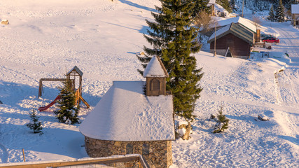 Small chapel at the mountain in a sunny winter morning