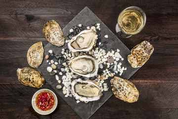 Overhead photo of oysters with wine and vinaigrette sauce