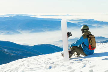Snowboarder enjoying a  beautiful scenery before him