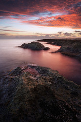 Flaming sunrise on Fond Ghadir Beach, Sliema, Malta