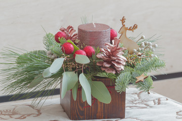 Decorative eucalyptus and candle Christmas centerpiece