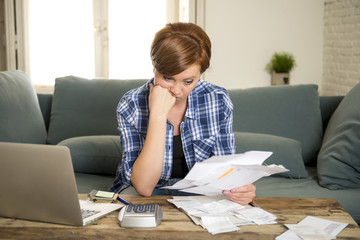 desperate woman banking and accounting home monthly and credit card expenses with computer laptop doing paperwork