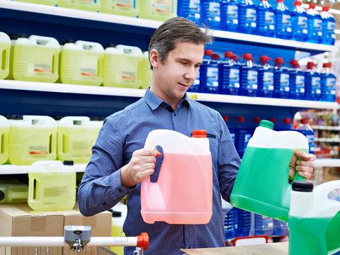 Man buys windshield washer fluid in shop