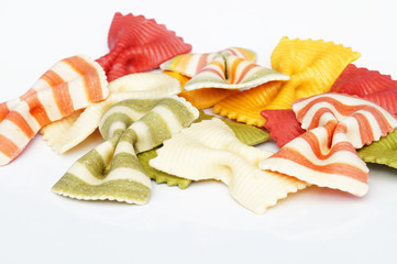 Beautiful colorful pasta in the shape of a butterfly isolated on white background. Striped pasta on a white background.