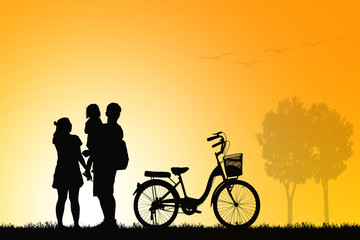 silhouette vintage bike family walking on blurry colorful sky at sunset time