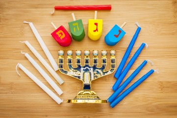 "The Jewish Hanukkah holiday concept stock image. Hebrew letters on dreidel teetotum say ""Nes Gadol Haya Poh"" (A great miracle happened here)."