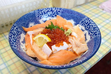 Sashimi raw fish with ikura and rice in bowl