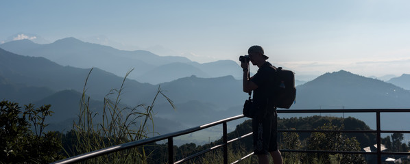 Silhouette of tourist make photo of scenic himalayas mountains, Pokhara, Nepal