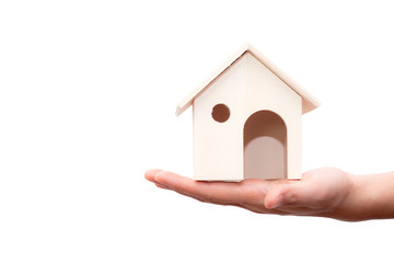 Hand holding house wooden isolated on white background. Concept of home loan, Insurance. This picture has clipping path for easy to use.