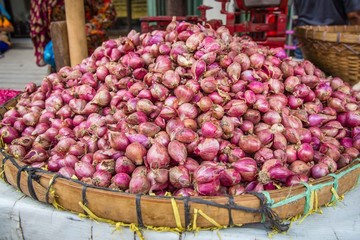 Onions in a basket on the market