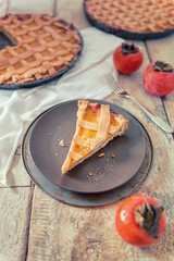 Slice sweet pie with persimmon fruits