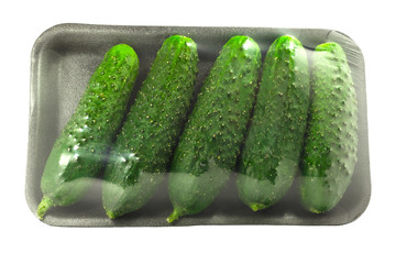 The packing of fresh cucumbers without label isolated on a white background with clipping path.