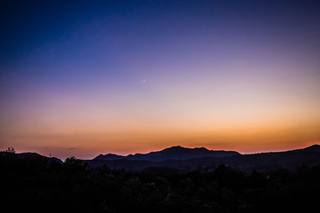 The evening, the hills, the moon, the sunset