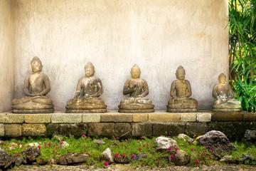 buddha figures of stone in garden in bali. indonesia