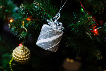 Silver Christmas decorations on the Christmas tree
