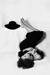 Black and white, woman lay down, full length, photo from above, legs, two beautyful hands, hat, girl dont look at camera jacket on naked body, accessories, long skirt, bw, isolate, fashion