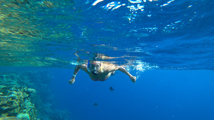 woman and snorkeling