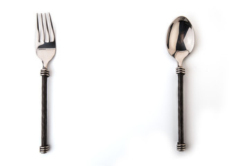 Closeup view of spoon and fork isolated on white background