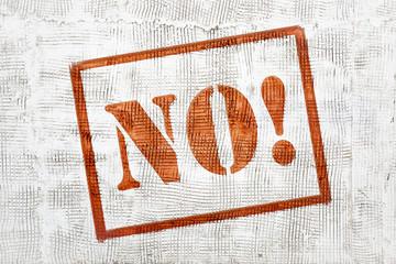 NO! Graffiti on white stucco wall