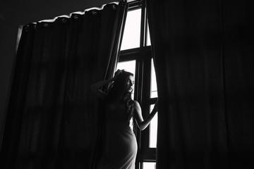 Portrait of woman near the window