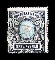 MOSCOW, RUSSIA - JUNE 26, 2017: A stamp printed in Russia shows postage stamp of the Russian Empire with the coat of arms, circa 1911