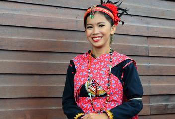 Portrait of Beautiful Malaysia Borneo Native Girl in Traditional Costumes.