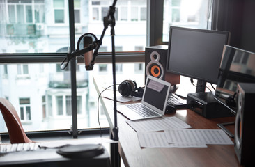 Modern computers, microphone near table in sound recording studio