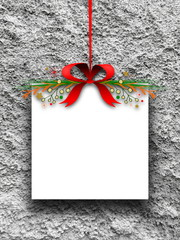 Blank Christmas square frame hanged by red ribbon against concrete wall background