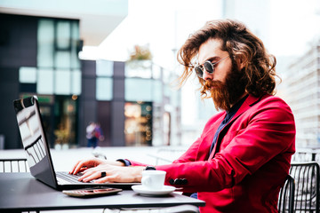 Hipster man working at computer