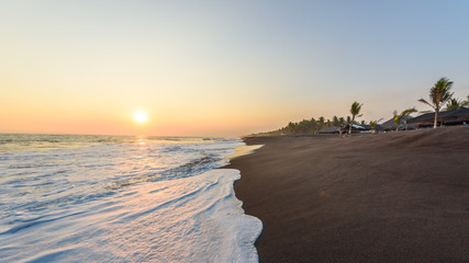 Sunset at Beach with Black Sand in Monterrico, Pacific coast of Guatemala.
