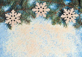 Christmas blue background with a pinecones and snow