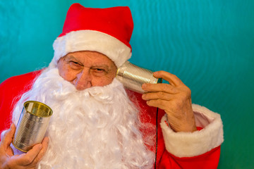 Santa Claus  with tin can telephone