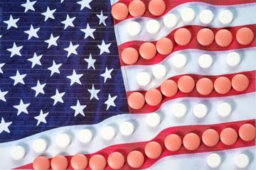 Pharmaceutical pills on American flag background
