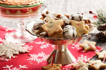 Variety of Homemade Xmas cookies, chocolate crinkles,shortbread on festive Christmas frame