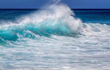 Aqua blue wave on the west side of Oahu Hawaii