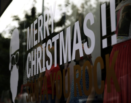 A Merry Christmas sign is seen on a window shop in Buenos Aires