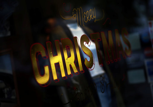 "The words ""Merry Christmas"" are seen on a window shop in Buenos Aires"