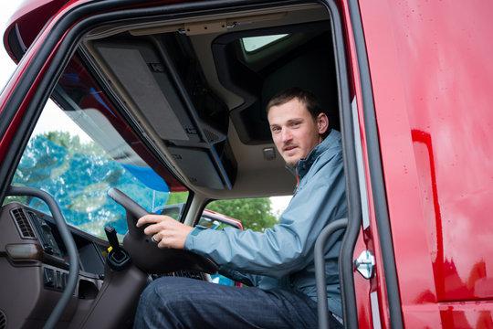 Truck driver in semi truck cab with modern dashboard