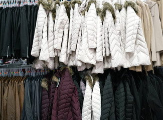 Hanging winter clothes in the store
