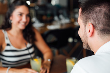 Couple drinking in a cafe