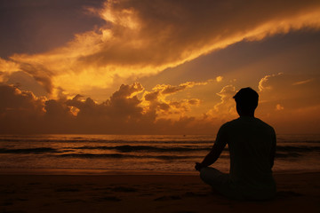 Yoga and meditation. Silhouette of Young man