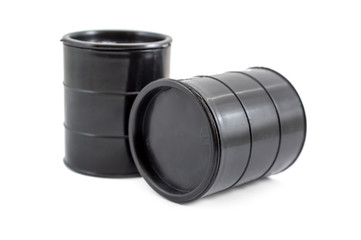 Two decorative black fuel oil barrel on white.