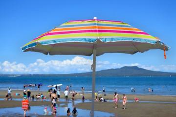 Colourful beach umbrella on a summer sunny day