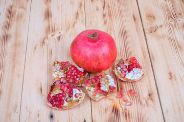 Fresh pomegranate on wooden table