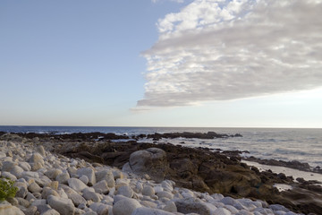 Stones on  Rocky Beach Seaside Sunny Day  Blue Sky Clouds