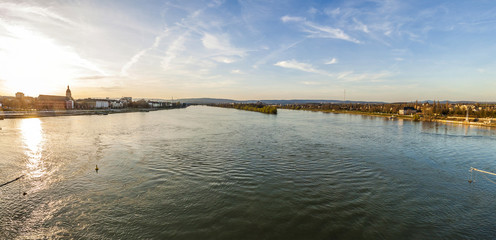 Panoramic view of river Rhine in Mainz and Wiesbaden city, Germany at sunset