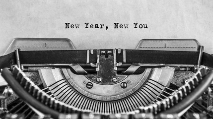 New Year New You message typed on old vintage typewriter. Cloce up