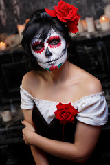 Photo of zombie girl with grim bodypainting on face