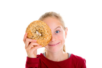 blond girl looking through a big bagle