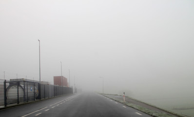 Fog over the Dyke in Nieuwerkerk aan den IJssel in netherlands